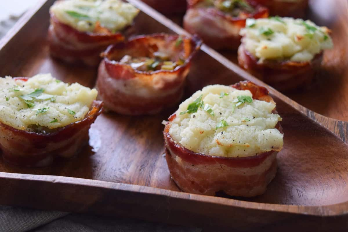 Close up view of bacon cups topped with mashed potatoes
