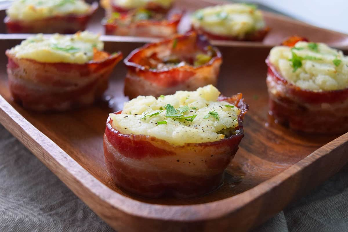 Close up view of bacon cups stuffed with mashed potatoes