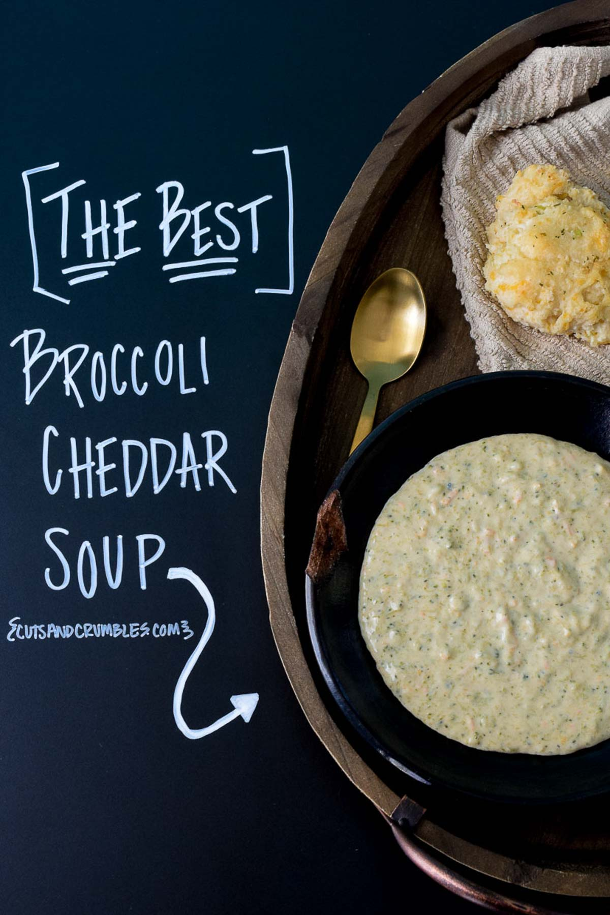 Broccoli Cheddar Soup served in a black bowl with title written on chalkboard